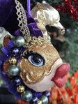 kissing fish masquerade gold